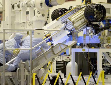 Engineers test-fit Curiosity's nuclear battery, July 2011, (NASA, Cory Huston)